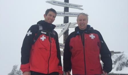 Photo of two dentists on ski patrol